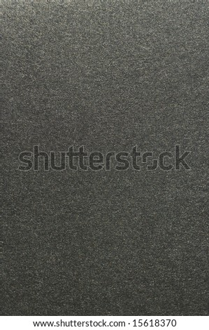 Close view of a sand-paper texture.