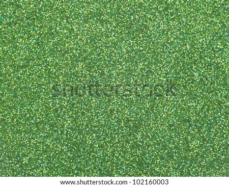 Close view of a surface with green glitter.