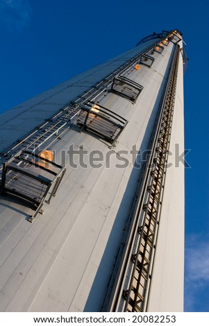 close view of a tall industrial chimney from the ground up