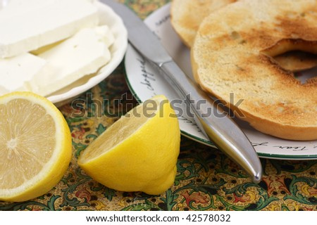 Close view of bagels and cream cheese - stock photo