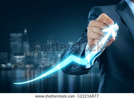 Close view of businessman drawing on screen growing graph #522216877