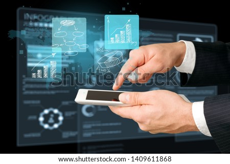 Close view of businessman with tablet and graphs and charts on screen #1409611868
