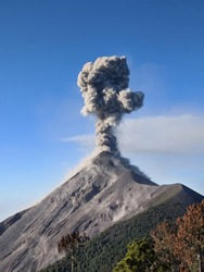 Close view of Fuego volcano eruption, molten rocks, hot ash, gas and smoke belched up from the crater during explosion. Acatenango volcano trek. Natural disaster in Guatemala, Central America.