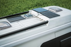 Close View Of Parked Camper Van With Three Solar Panels On Top Of Roof.