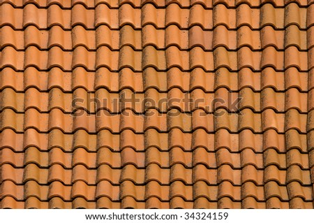 Close view of red roof tiles.