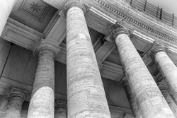 Close view of the colums of the Saint Peter's square in Vatican in black and white, Rome, Italy