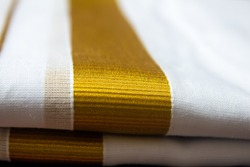 Close view of the dhoti with gold threaded border. Dhoti is a traditional south indian dress wore by men during festivals, marriages.