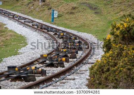 Close view of tram rail tracks showing the cable system which pulls the trams along #1070094281