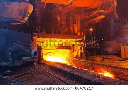 Close view of working blast furnace at the metallurgical plant