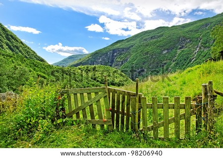 Close wood gate on the mountain pasture.