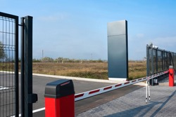 Closed automatic gate of the barrier. Automatic security system for private areas. Automatic entry system, parking barrier.