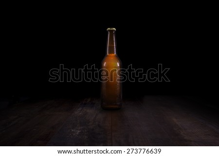 Closed beer bottle on a rustic table