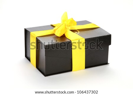 closed Black cardboard box with yellow tape