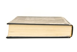 Closed book on white background. Close up.