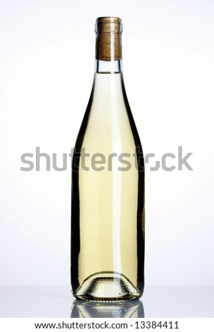 Closed bottle of white wine on white background