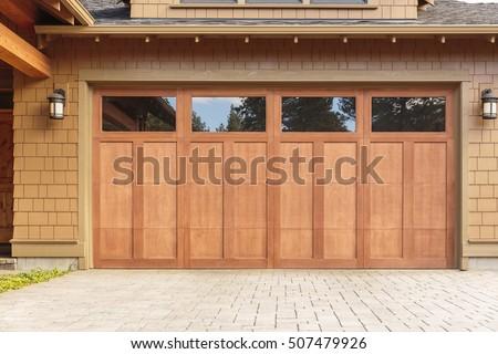 Closed brown garage door with windows