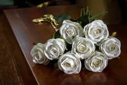 Closed coffin with white roses on the coffin lid, death of a person, burial, mortality of the population.