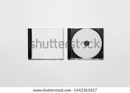 Closed compact plastic Disc Box Case with white isolated blank for branding design. CD jewel mock-up on soft gray background  Сток-фото ©