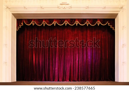closed crumpled red curtain...