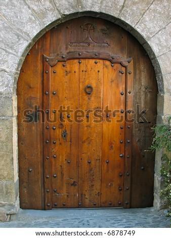 Closed door in Ainsa - stock photo
