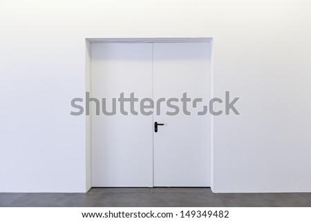 closed door white building...