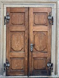 Closed doors at the Castle Czech Krumlov. Old wooden decorative door. Historical door with decorative ironwork to the castle Cesky Krumlov, Czech republic.
