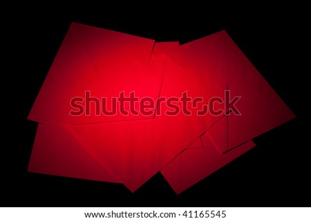 closed envelopes with red spot light on black background
