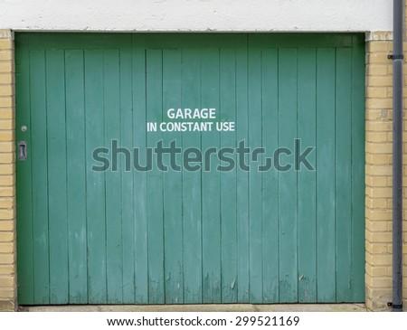 Closed garage door with sign \'Garage In Constant Use\'