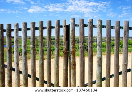 Closed gate in entrance of  farm