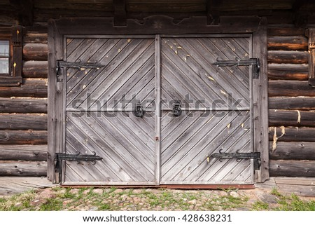 closed gate in old wooden wall  ...