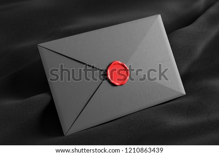 Closed gray envelope with red stamp lying on black tissue. Communication concept. 3d rendering mock up stock photo