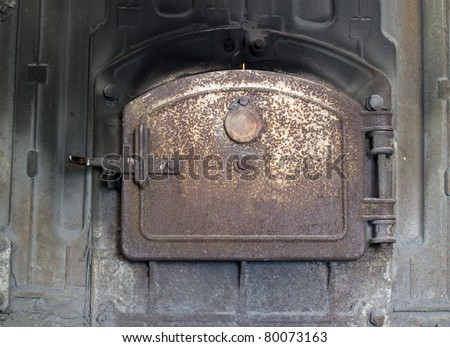 Closed iron stove in boiler room