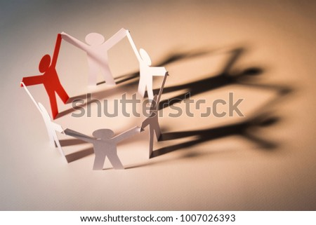 closed joining of six paper figure in hand up posture on light background. in concept of cooperation, successful and leadership.