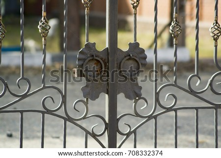 Closed metal forged gate close-up #708332374