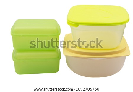 Closed plastic food containers isolated on white background