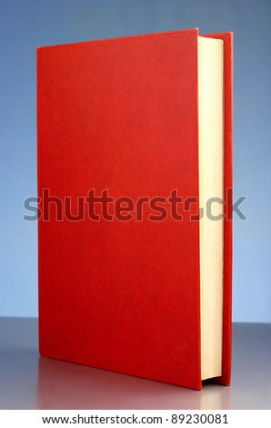 closed red book on a blue gradient background