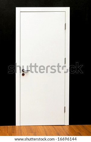 Closed simple white door in home interior