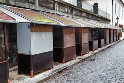 Closed stalls in the market in old europe town. Offseason concept