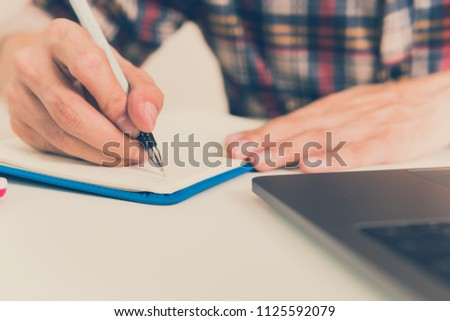 closed up businessman writing on notebook on wooden table, Concept finance planing and analyzes management. Foto d'archivio ©