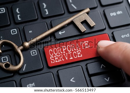 Closed up finger on keyboard with word CORPORATE SERVICE #566513497