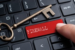 Closed up finger on keyboard with word FIREWALL