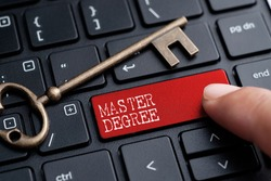 Closed up finger on keyboard with word MASTER DEGREE