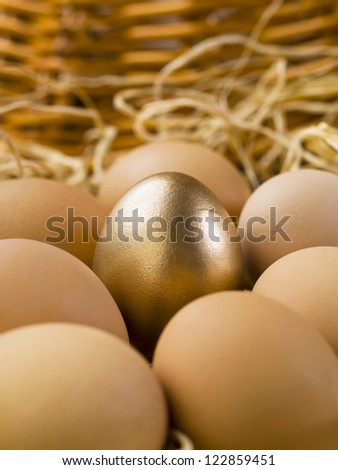 Closed up image of gold eggs with brown eggs