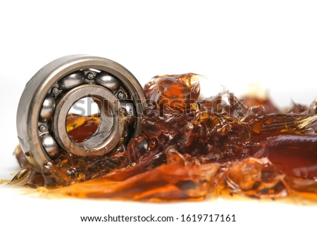Closed up macro, ball bearing put into yellow transparent lithium grease isolated on white background with copy space, engineering and industrial concept Сток-фото ©