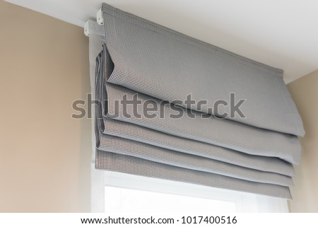 closed up of beautiful  grey curtain in cozy room home, interior design concept