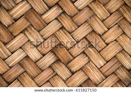 Closed up of brown color wooden weave texture background #615827150