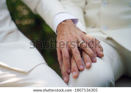 closed up of man hands with wedding ring on man hands in concept of LGBT gay or bisexual wedding ceremony Stockfoto ©
