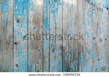 closed up of old wood background. Vintage wood background with blue color peeling paint.