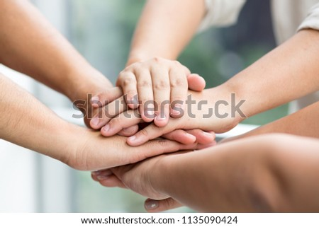 Closed up 3 persons doing hand to show cooperation is a tactic. To build morale. go to same goal,objective ストックフォト ©