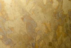 closed up random pattern patina effect on brass plate